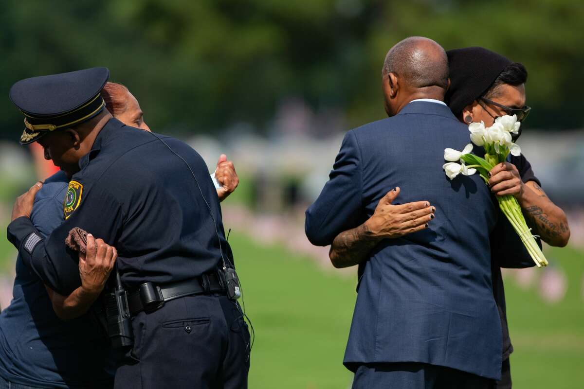 Houston Police Department Chief Troy Finner, left, embraces Janie Torres, the sister of Jose