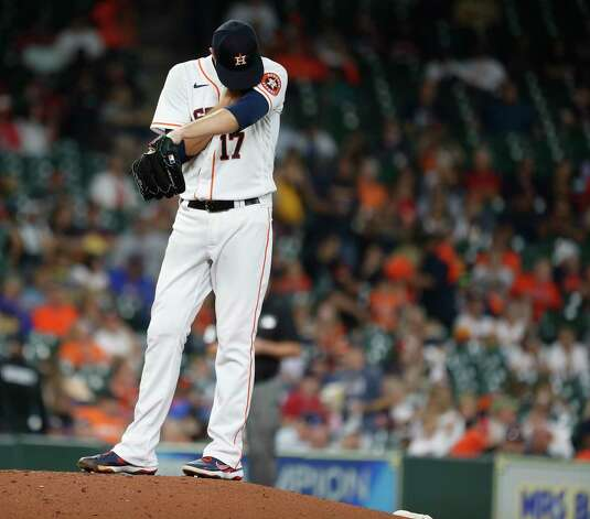 Houston Astros starting pitcher Jake Odorizzi (17) reacts after Boston Red Sox Hunter Renfroe's single during the third inning of an MLB baseball game at Minute Maid Park, Thursday, June 3, 2021, in Houston. Photo: Karen Warren, Staff Photographer / @2021 Houston Chronicle