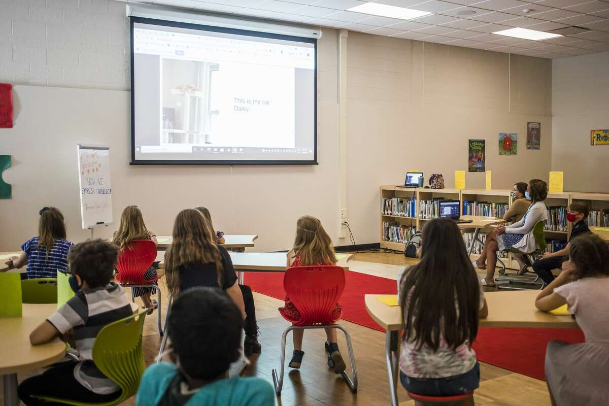 Fifth graders at Chestnut Hill Elementary present their final PYP exhibition video projects Thursday, June 3, 2021 at the school in Midland. The students each picked an issue that they care about, researched the topic and even took action towards a solution. (Katy Kildee/kkildee@mdn.net)