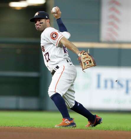 Houston Astros designated hitter Jose Altuve (27) makes the throw to first base as Boston Red Sox Kevin Plawecki ground out during the second inning of an MLB baseball game at Minute Maid Park, Thursday, June 3, 2021, in Houston. Photo: Karen Warren, Staff Photographer / @2021 Houston Chronicle