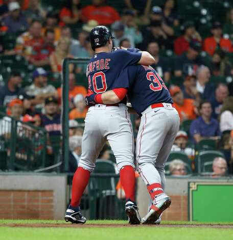 Boston Red Sox Christian Arroyo (39) celebrates his three-run home run with Hunter Renfroe  during the second inning of an MLB baseball game at Minute Maid Park, Thursday, June 3, 2021, in Houston. Photo: Karen Warren, Staff Photographer / @2021 Houston Chronicle