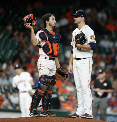 Houston Astros starting pitcher Jake Odorizzi (17) chats with catcher Garrett Stubbs (11) after Boston Red Sox Hunter Renfroe's single during the third inning of an MLB baseball game at Minute Maid Park, Thursday, June 3, 2021, in Houston. Photo: Karen Warren, Staff Photographer / @2021 Houston Chronicle