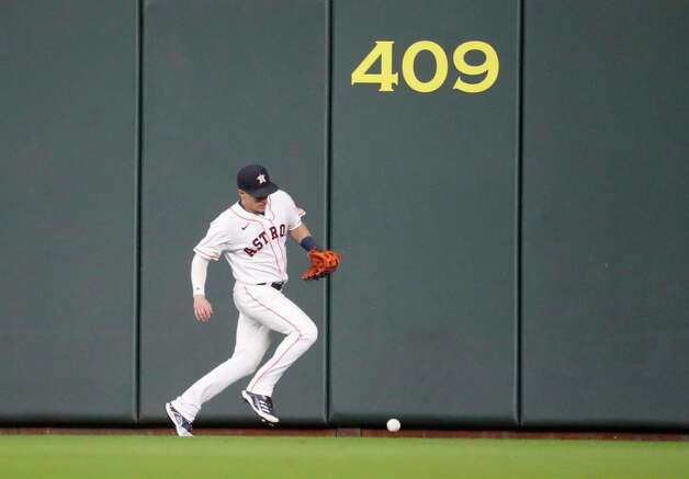 Houston Astros center fielder Myles Straw (3) chases Boston Red Sox Rafael Devers' double during the second inning of an MLB baseball game at Minute Maid Park, Thursday, June 3, 2021, in Houston. Photo: Karen Warren, Staff Photographer / @2021 Houston Chronicle