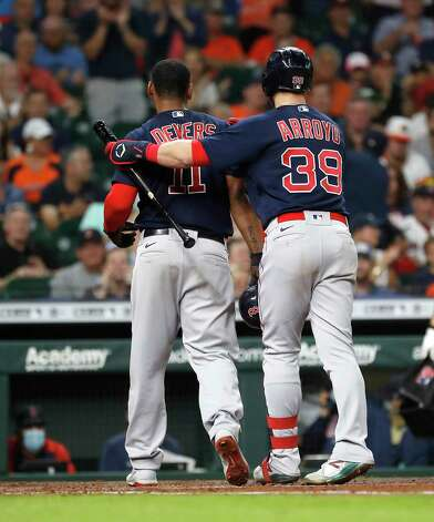 Boston Red Sox Rafael Devers (11) is consoled by Christian Arroyo (39) after he was caught stealing home to end the top of the third inning of an MLB baseball game at Minute Maid Park, Thursday, June 3, 2021, in Houston. Photo: Karen Warren, Staff Photographer / @2021 Houston Chronicle