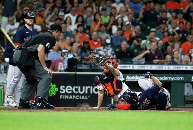 Houston Astros catcher Garrett Stubbs (11) catches Boston Red Sox Rafael Devers (11) stealing home to end the top of the third inning of an MLB baseball game at Minute Maid Park, Thursday, June 3, 2021, in Houston. Photo: Karen Warren, Staff Photographer / @2021 Houston Chronicle