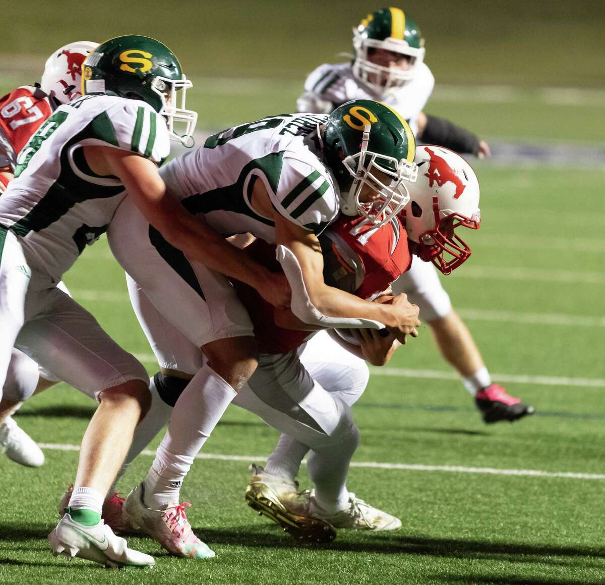 Mason Sanders (11) of the Memorial Mustangs is brought down by Anthony Cuhel (19) of the Stratford Spartans in the second half during a High School football game on Friday, October 30, 2020 at Tully Stadium in Houston Texas.