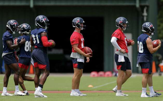 Houston Texans quarterback and running backs wait to go though a ball carrier drill during an OTA practice at the Houston Methodist Training Center on Thursday, June 3, 2021, in Houston. Photo: Godofredo A. Vásquez, Staff Photographer / © 2021 Houston Chronicle