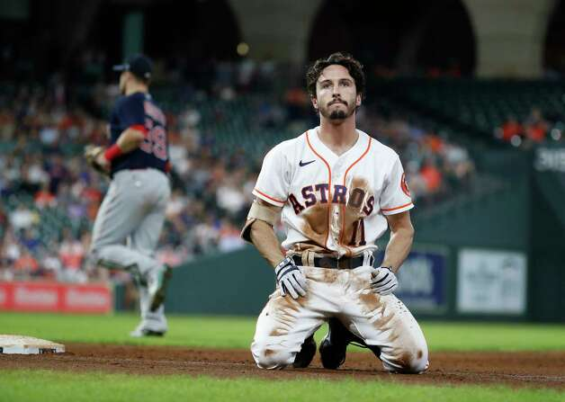 Houston Astros Garrett Stubbs (11) reacts after sliding into first base as he ground out to end the fifth inning of an MLB baseball game at Minute Maid Park, Thursday, June 3, 2021, in Houston. Photo: Karen Warren, Staff Photographer / @2021 Houston Chronicle