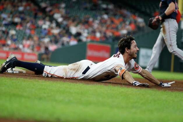 Houston Astros Garrett Stubbs (11) slides into first base as he ground out to end the fifth inning of an MLB baseball game at Minute Maid Park, Thursday, June 3, 2021, in Houston. Photo: Karen Warren, Staff Photographer / @2021 Houston Chronicle