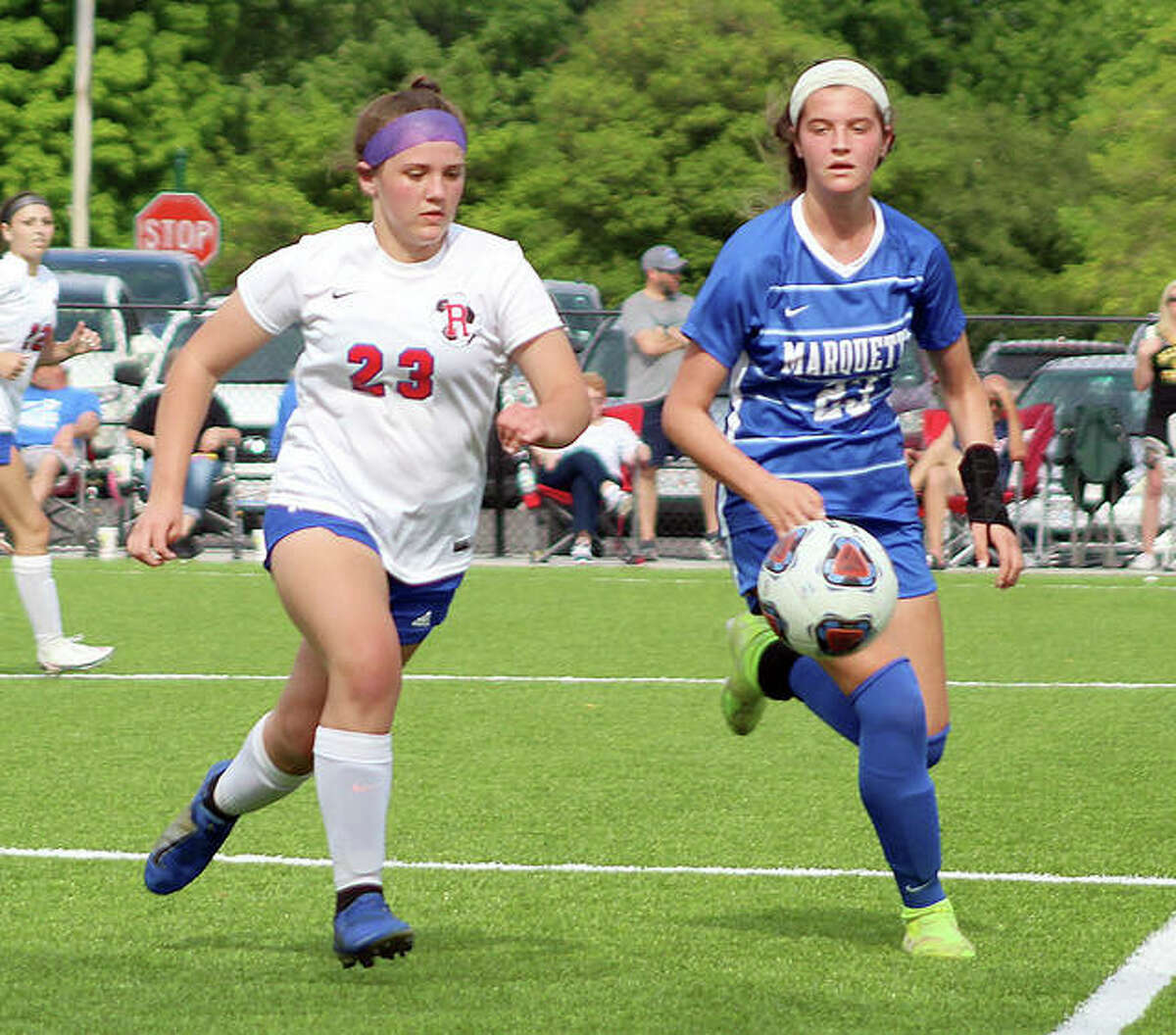 Roxana's Kinsley Mouser, left, and Marquette's Jillian Nelson chase the ball during a game earlier this season.