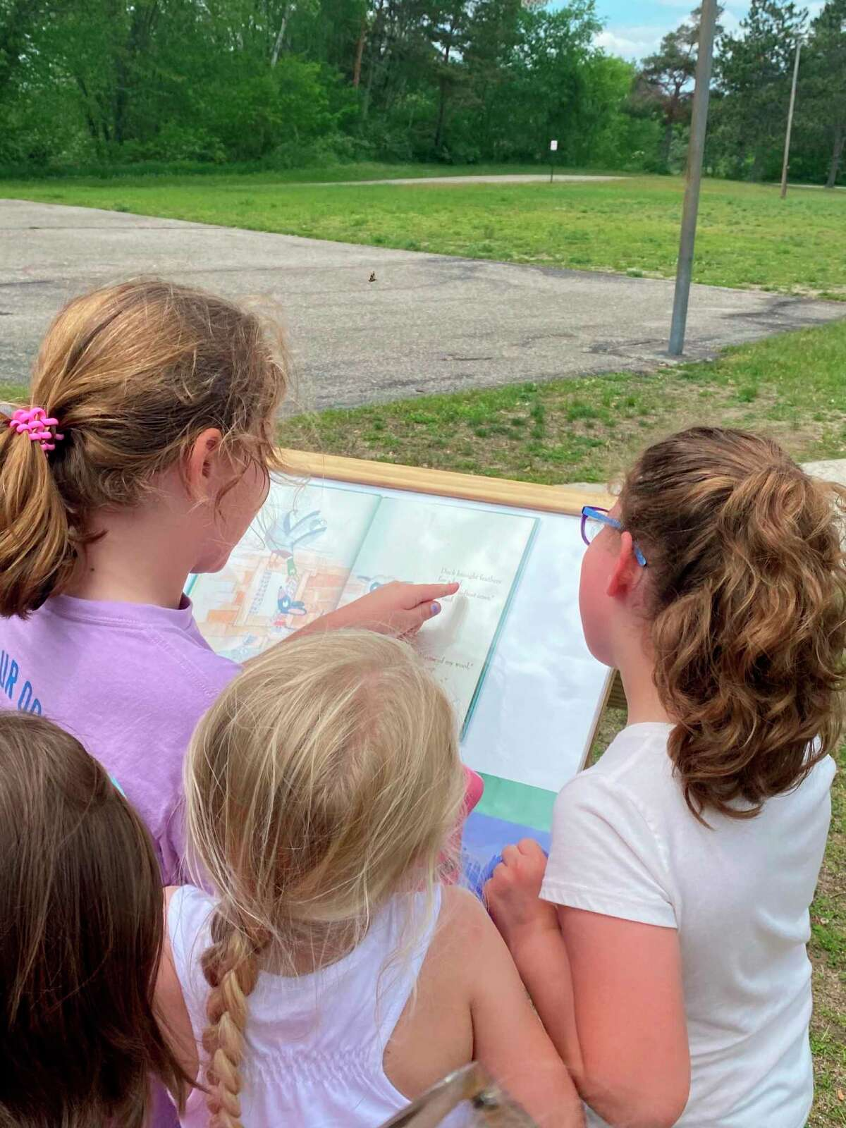 Kylene Nix, a Reed City teacher who also serves as treasurer with the RCADL, had her first-grade class from G.T. Norman Schools visit the StoryWalk in Westburg Park. (Courtesy/Kylene Nix)