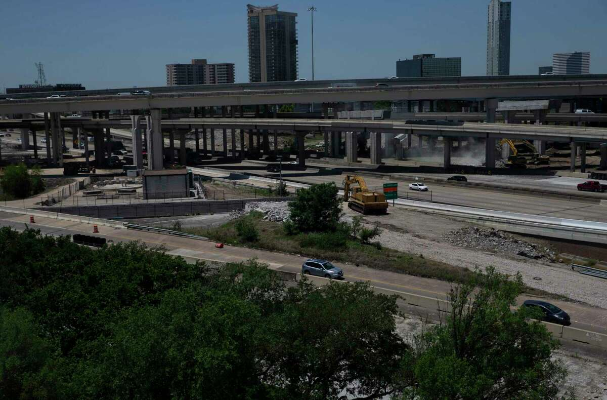 Traffic passes construction equipment on the ramp connecting Loop 610 to Interstate 69 northbound on May 6, 2021, in Houston. Crews closed the ramp from I-69 northbound to Loop 610 northbound Thursday evening.