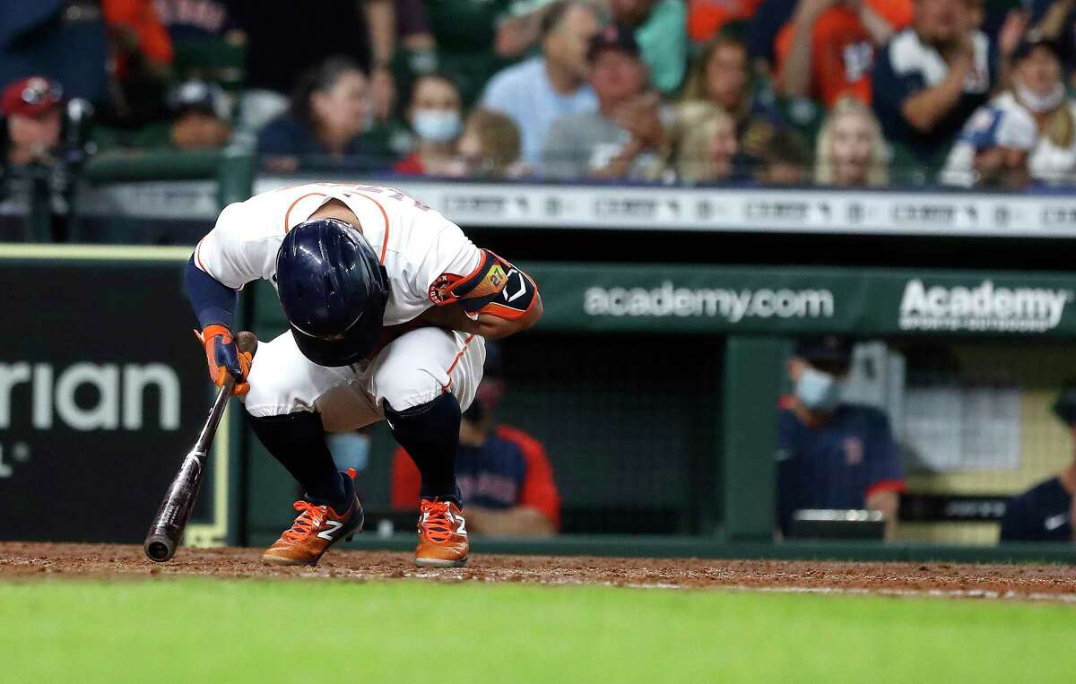 Houston Astros designated hitter Jose Altuve (27) reacts after being called out on strikes against Boston Red Sox starting pitcher Martin Perez during the sixth inning of an MLB baseball game at Minute Maid Park, Thursday, June 3, 2021, in Houston.