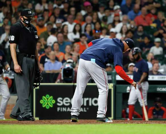 Boston Red Sox manager Alex Cora (13) argues with home plate umpire Lance Barrett during the sixth inning of an MLB baseball game at Minute Maid Park, Thursday, June 3, 2021, in Houston. Photo: Karen Warren, Staff Photographer / @2021 Houston Chronicle