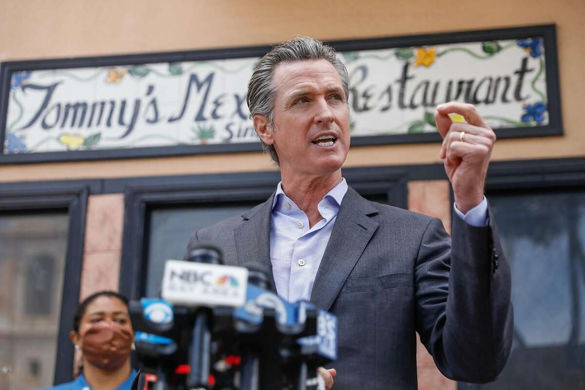 Gov. Gavin Newsom speaks during a press conference to discuss the measures the state is taking to support restaurants and bars ahead of California's June 15 reopening on Thursday, June 3, 2021 in San Francisco, California.