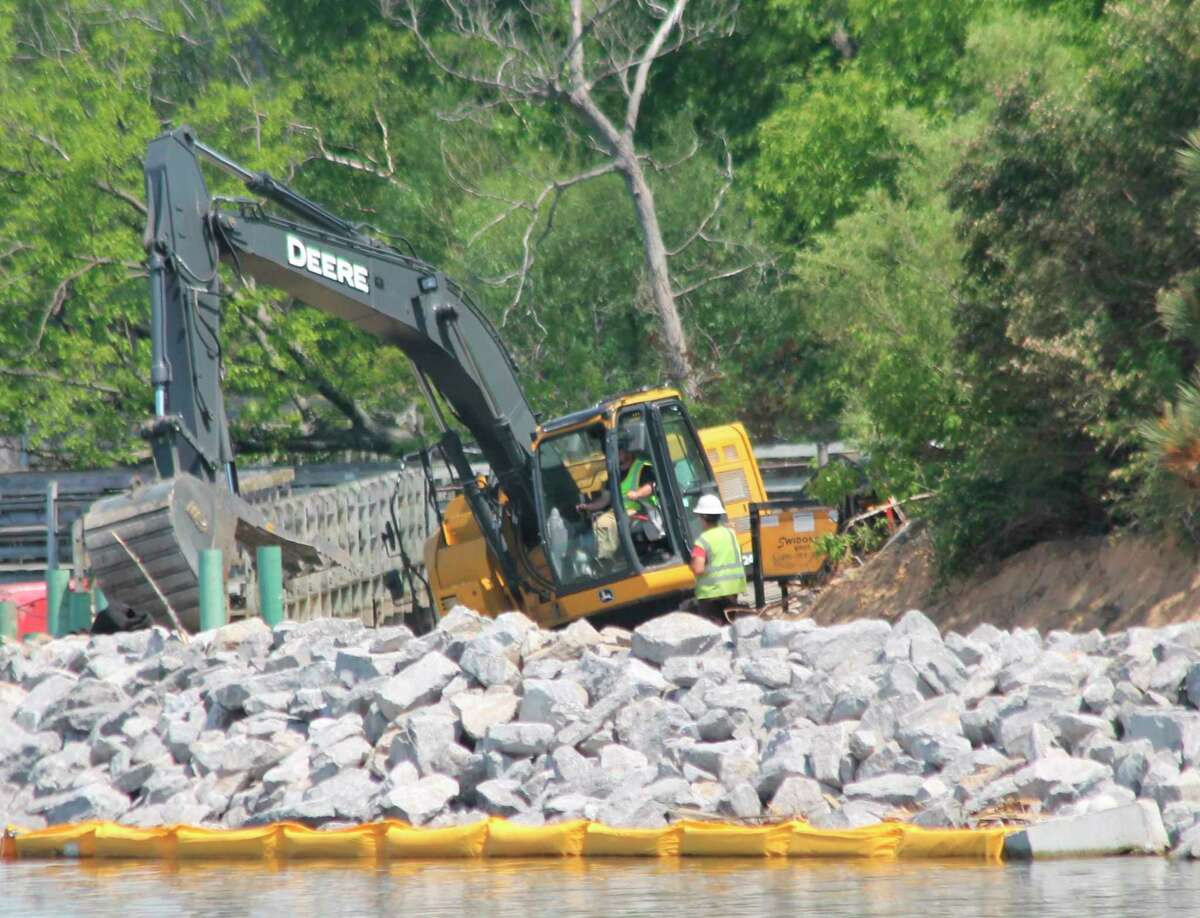 An excavator works along the shore during repairs to the Manistee Riverwalk on Wednesday. (Kyle Kotecki/News Advocate)
