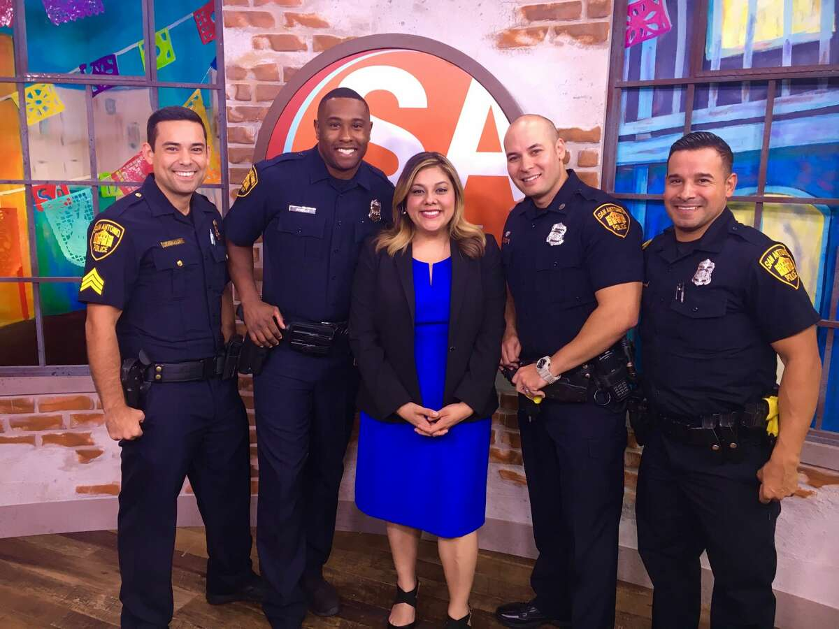 SAPD spokeswoman Jennifer Rodriguez and a few police officers on set of SA Live.
