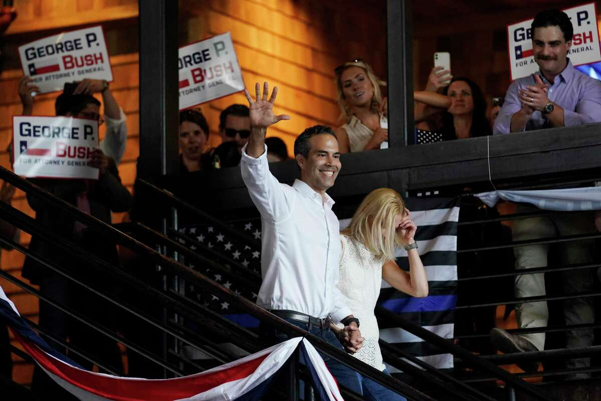 Texas Land Commissioner George P. Bush arrives for a kick-off rally with his wife Amanda to announced he will run for Texas Attorney General, Wednesday, June 2, 2021, in Austin, Texas. (AP Photo/Eric Gay)