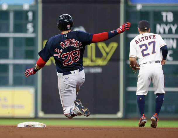 Boston Red Sox J.D. Martinez (28) slides into second base on his double off of Houston Astros relief pitcher Cristian Javier during the seventh inning of an MLB baseball game at Minute Maid Park, Thursday, June 3, 2021, in Houston. Photo: Karen Warren, Staff Photographer / @2021 Houston Chronicle