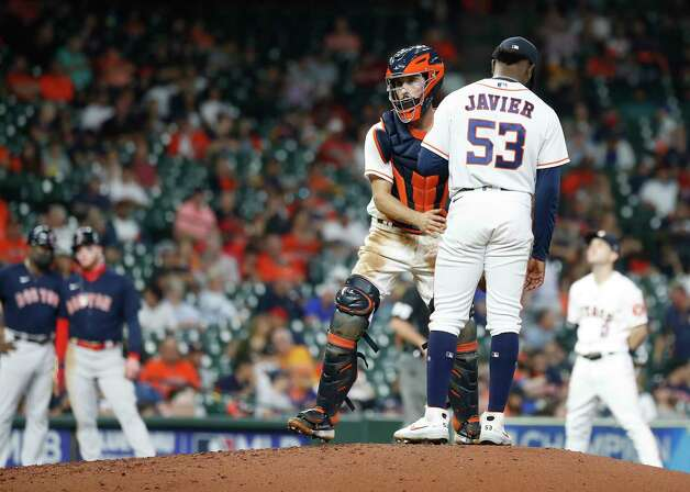 Houston Astros relief pitcher Cristian Javier (53) chats with catcher Garrett Stubbs (11) after Boston Red Sox J.D. Martinez's double during the seventh inning of an MLB baseball game at Minute Maid Park, Thursday, June 3, 2021, in Houston. Photo: Karen Warren, Staff Photographer / @2021 Houston Chronicle