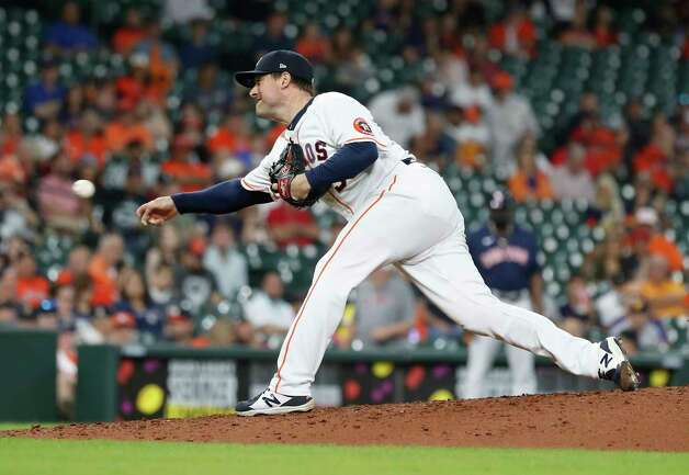 Houston Astros relief pitcher Joe Smith (38) pitches during the eighth inning of an MLB baseball game at Minute Maid Park, Thursday, June 3, 2021, in Houston. Photo: Karen Warren, Staff Photographer / @2021 Houston Chronicle