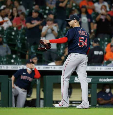Boston Red Sox starting pitcher Martin Perez (54) points back as he was pulled during the eighth inning of an MLB baseball game at Minute Maid Park, Thursday, June 3, 2021, in Houston. Photo: Karen Warren, Staff Photographer / @2021 Houston Chronicle