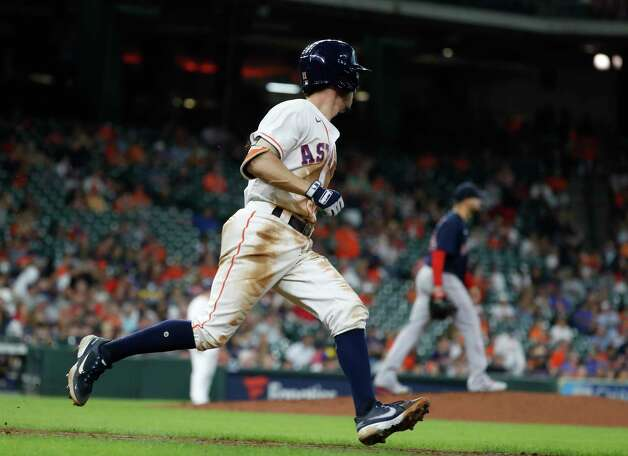 Houston Astros Garrett Stubbs (11) runs to first base on his single off of Boston Red Sox starting pitcher Martin Perez during the eighth inning of an MLB baseball game at Minute Maid Park, Thursday, June 3, 2021, in Houston. Photo: Karen Warren, Staff Photographer / @2021 Houston Chronicle