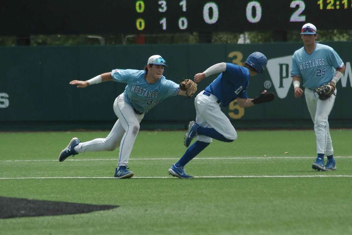 Friendswood shortstop Izaac Pacheco (34) runs down Barbers Hill's Cameron Cauley during the Region 3-5A championship series.