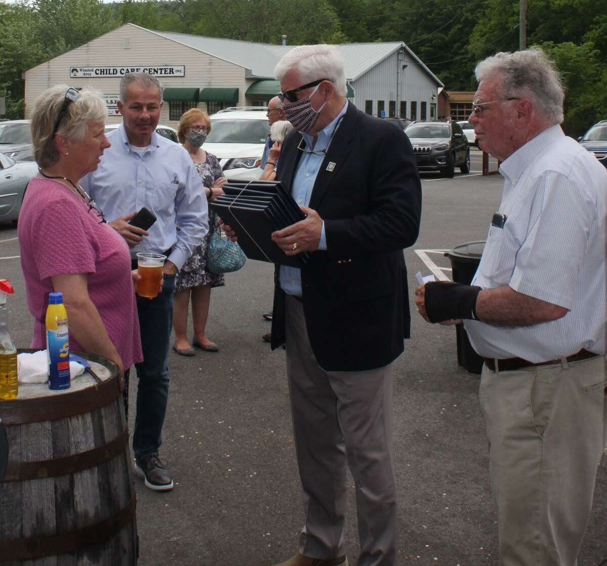 Winchester's Democratic Town Committee on May 23 presented its Legacy Award Recognition Program at Little Red Barn Brewers on Lake Street. Mayor Candy Perez, left, chats with Congressman John Larson, right, and committee member George Closson, far right.