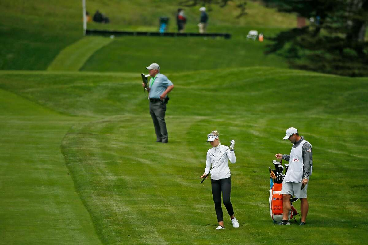 Nelly Korda takes a golf club to hit off the rough towards the sixth hole during the first round of the 76th U.S. Women's Open Championship at the Olympic Club, Thursday, June 3, 2021, in San Francisco, Calif.
