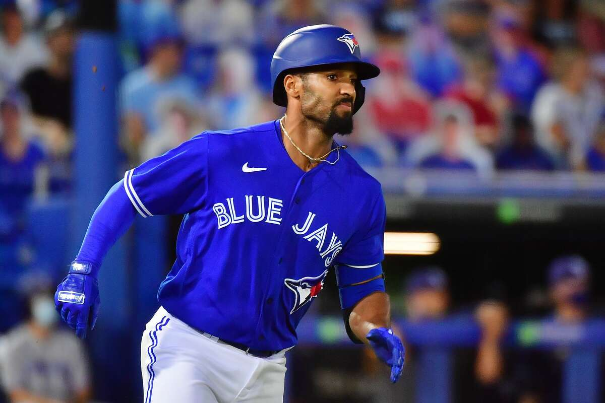 DUNEDIN, FLORIDA - MAY 21: Marcus Semien #10 of the Toronto Blue Jays runs down the first base line after hitting an RBI triple against the Tampa Bay Rays in the second inning at TD Ballpark on May 21, 2021 in Dunedin, Florida. (Photo by Julio Aguilar/Getty Images)