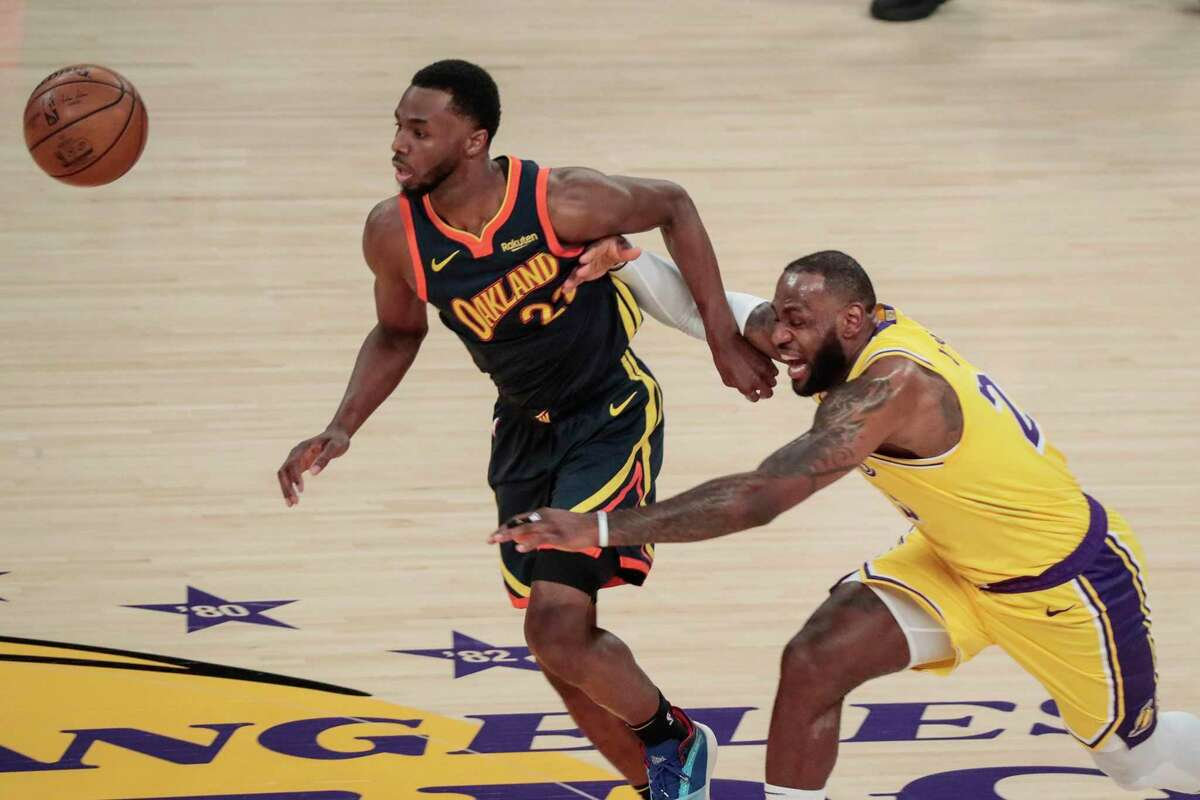 The Los Angeles Lakers' LeBron James, right, knocks the ball away from the Golden State Warriors' Andrew Wiggins during first-half action in a play-in playoff game at Staples Center in Los Angeles on Wednesday, May 19, 2021. (Robert Gauthier/Los Angeles Times/TNS)