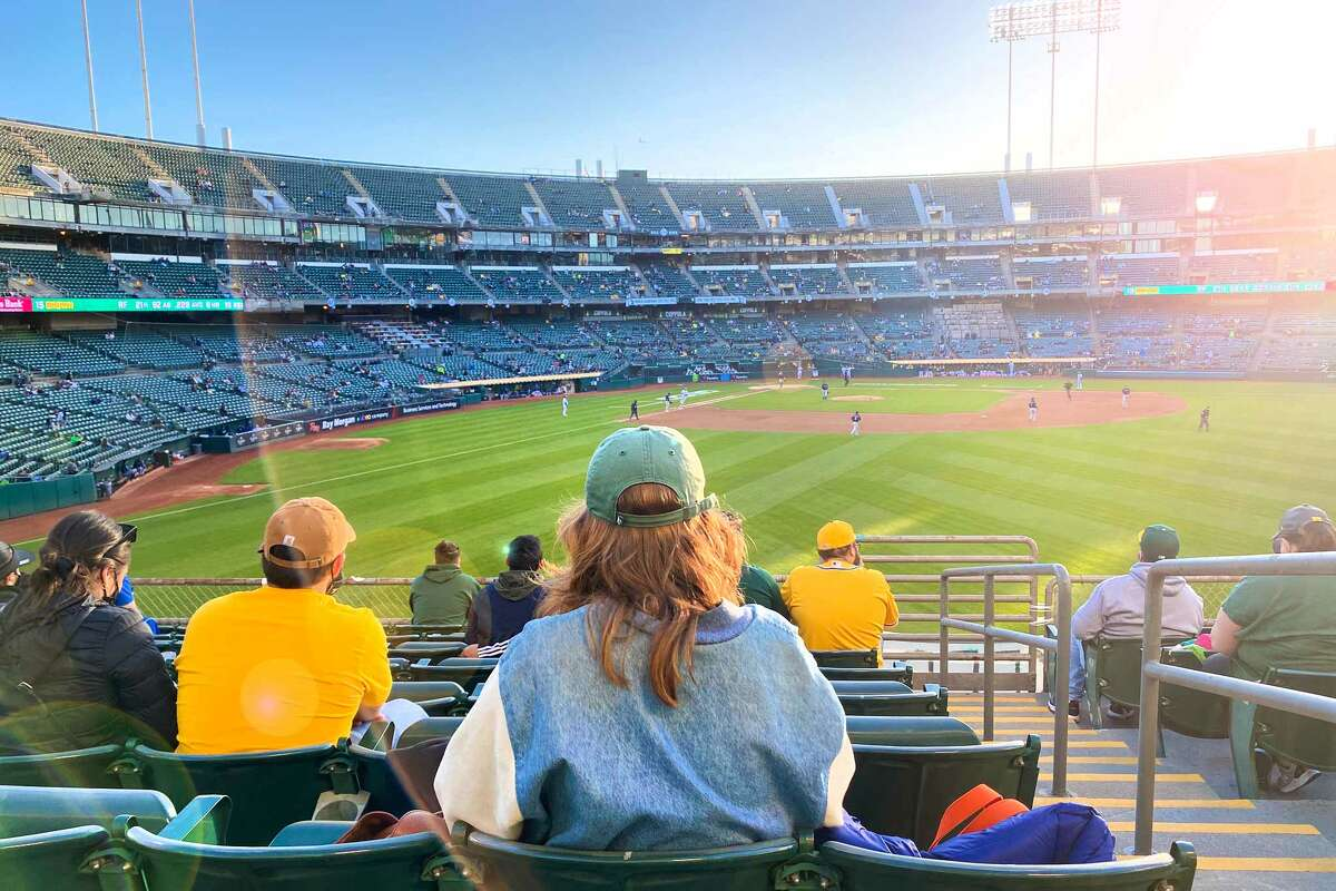 SFGATE reporter Madeline Wells watches the Oakland Athletics play against the Seattle Mariners in RingCentral Coliseum on May 25, 2021 in Oakland, Calif.