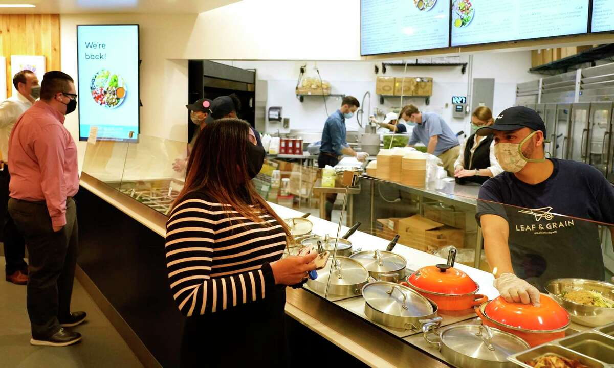 People wait in line at Leaf & Grain at the food court in One Allen Center, 500 Dallas St., on the tunnel level Thursday, April 8, 2021 in Houston. Business is starting to pick up downtown as offices begin a gradual return to in-person work amid the COVID-19 pandemic.
