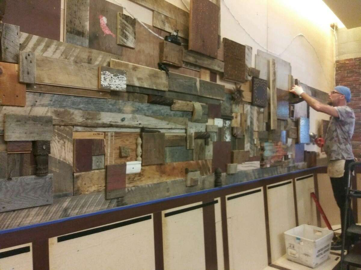 Albany artist Chip Fasciana installs a wall of repurposed wood in the forthcoming restaurant SideBar, due to open in August at 30 S. Pearl St. in Albany. The space previously was home to the restaurants Dale Miller and Taste. (Provided photo.)