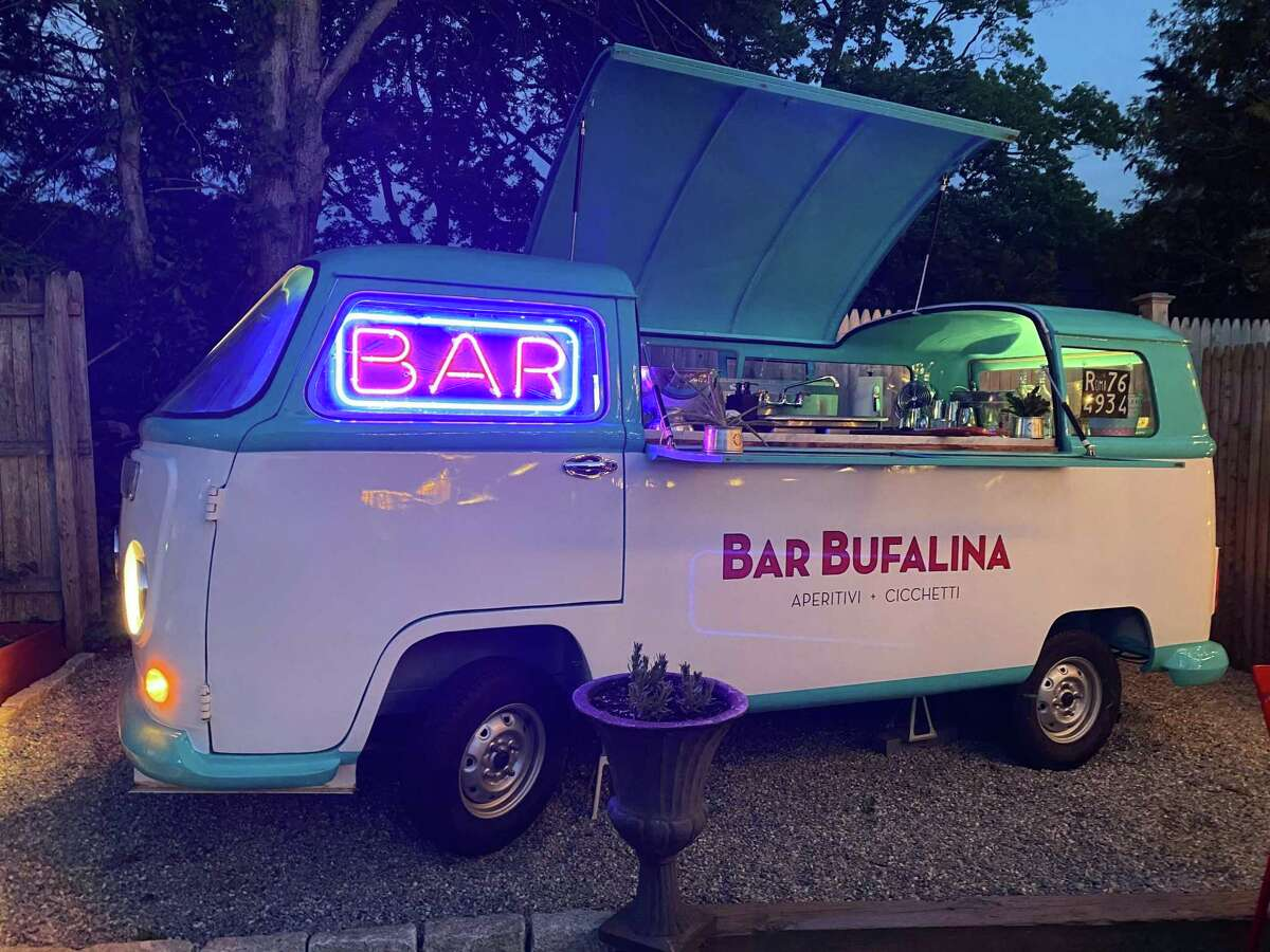 Bufalina's new outdoor bar is a converted VW Bus.