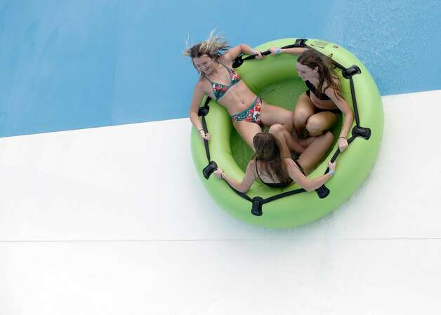 Guest ride a large inflatable on Storm Surge at Big Rivers Waterpark & Adventures, Thursday, June 3, 2021, in New Caney. Grand Texas is a 632-acre development in New Caney consisting of two major parks spanning 80 acres: Big Rivers Waterpark and Gator Bayou Adventure Park. The entire development also boasts a racing park, RV resort and a shopping and dining district. Photo: Jason Fochtman/Staff Photographer / 2021 ? Houston Chronicle