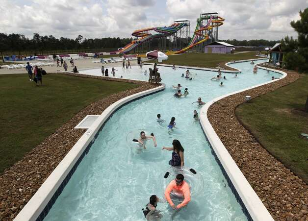 Guests enjoy the Rio Grand River at Big Rivers Waterpark & Adventures, Thursday, June 3, 2021, in New Caney. Grand Texas is a 632-acre development in New Caney consisting of two major parks spanning 80 acres: Big Rivers Waterpark and Gator Bayou Adventure Park. The entire development also boasts a racing park, RV resort and a shopping and dining district. Photo: Jason Fochtman/Staff Photographer / 2021 ? Houston Chronicle