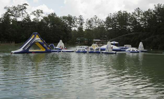 Guests enjoy Wild Isle, a floating waterpark and challenge course at Big Rivers Waterpark & Adventures, Thursday, June 3, 2021, in New Caney. The parks plants to triple the size of Wild Isle by the July 4th weekend. Grand Texas is a 632-acre development in New Caney consisting of two major parks spanning 80 acres: Big Rivers Waterpark and Gator Bayou Adventure Park. The entire development also boasts a racing park, RV resort and a shopping and dining district. Photo: Jason Fochtman/Staff Photographer / 2021 ? Houston Chronicle