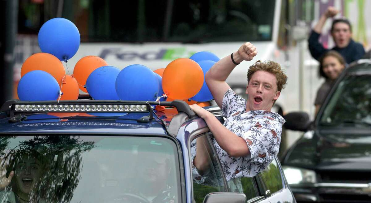 Danbury High School seniors enjoyed a car parade through downtown organized by the Parent Teacher Organization on Thursday afternoon. The parade included decorated cars, fire and police vehicles and was escorted by the Danbury Police Department motorcycle unit. June 3, 2021, in Danbury, Conn.