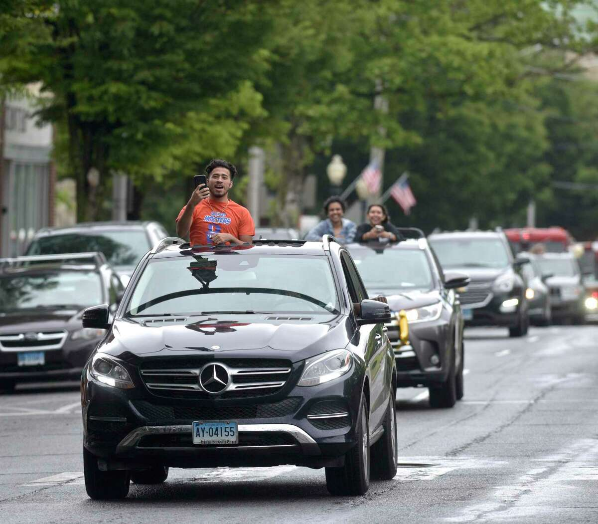 Danbury High School seniors enjoyed a car parade through downtown organized by the schools Parent Teacher Organization on Thursday afternoon. The parade included decorated cars, fire and police vehicles and was escorted by the Danbury Police Department motorcycle unit. June 3, 2021, in Danbury, Conn.