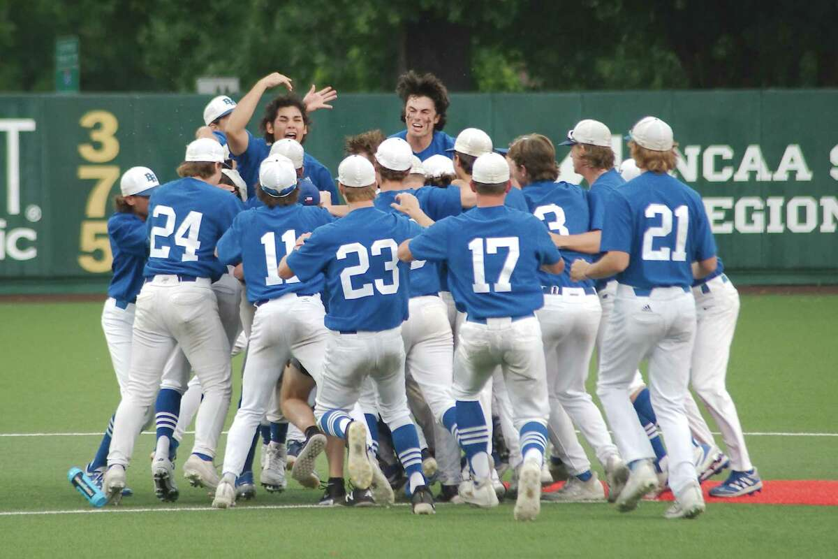 Barbers Hill celebrates after defeating Friendswood to advance to the state baseball tournament for the first time in school history.