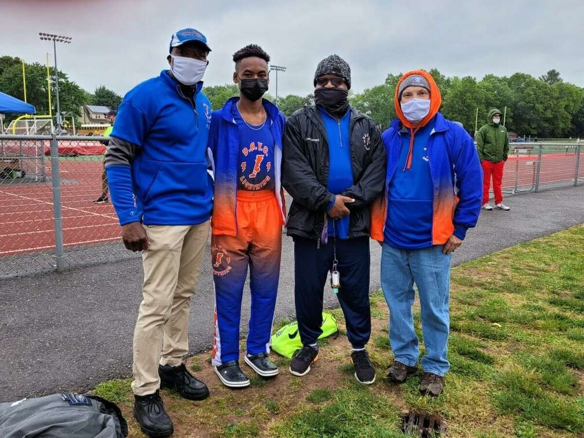 Luke Richardson, from the Danbury Athletic Youth Organization Lightning team, won first place in two races on Saturday, May 29, 2021. From left to right: Hubert Parris, head coach and commissioner, Luke Richardson, of Bethel, Darren Joseph, coach, Sean Campanella, sprints coach.