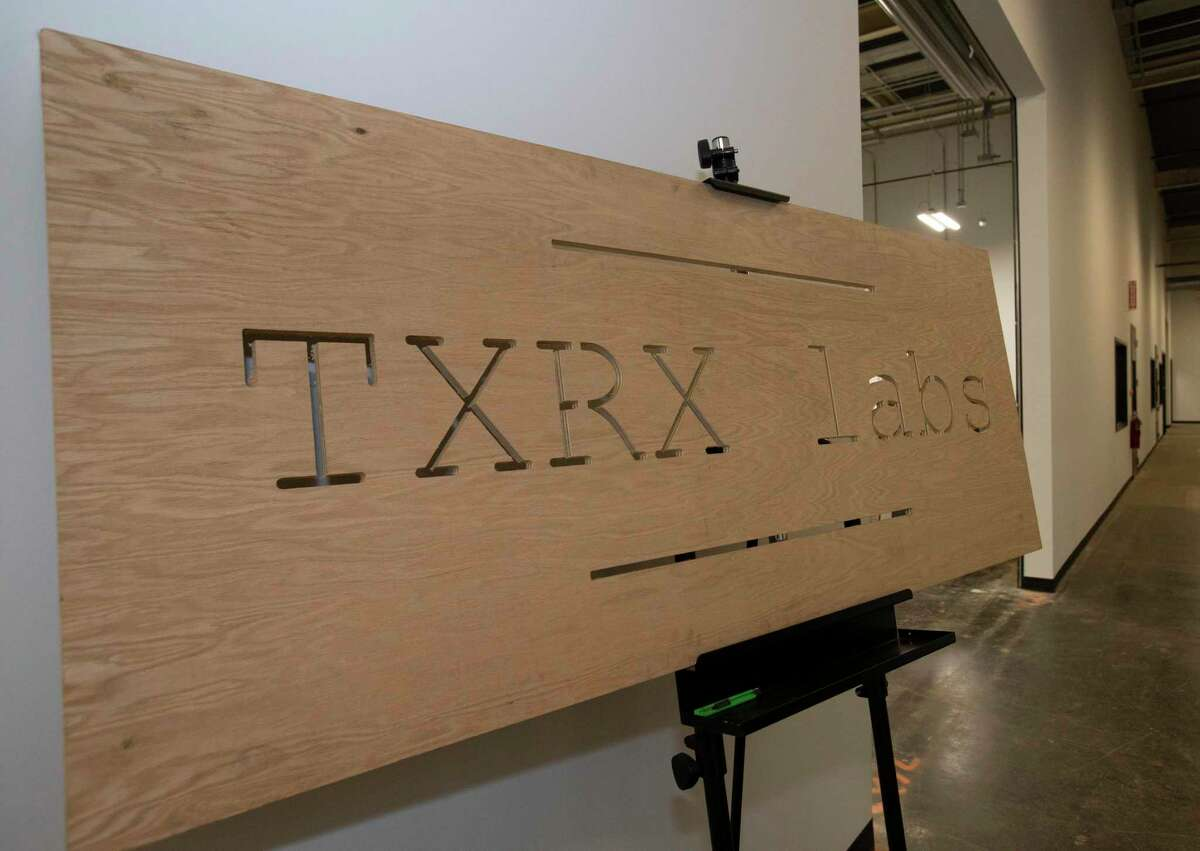 A TXRX Labs sign is presented during a tour at the opening ceremony of East End Maker Hub Thursday, June 3, 2021, in Houston. The 21-acre hub, a campus for traditional manufacturing, hardware innovations, fabricators and biomanufacturing and medical device companies, aims to turn the East End which has roots in the manufacturing industry, into a national manufacturing hub once more.