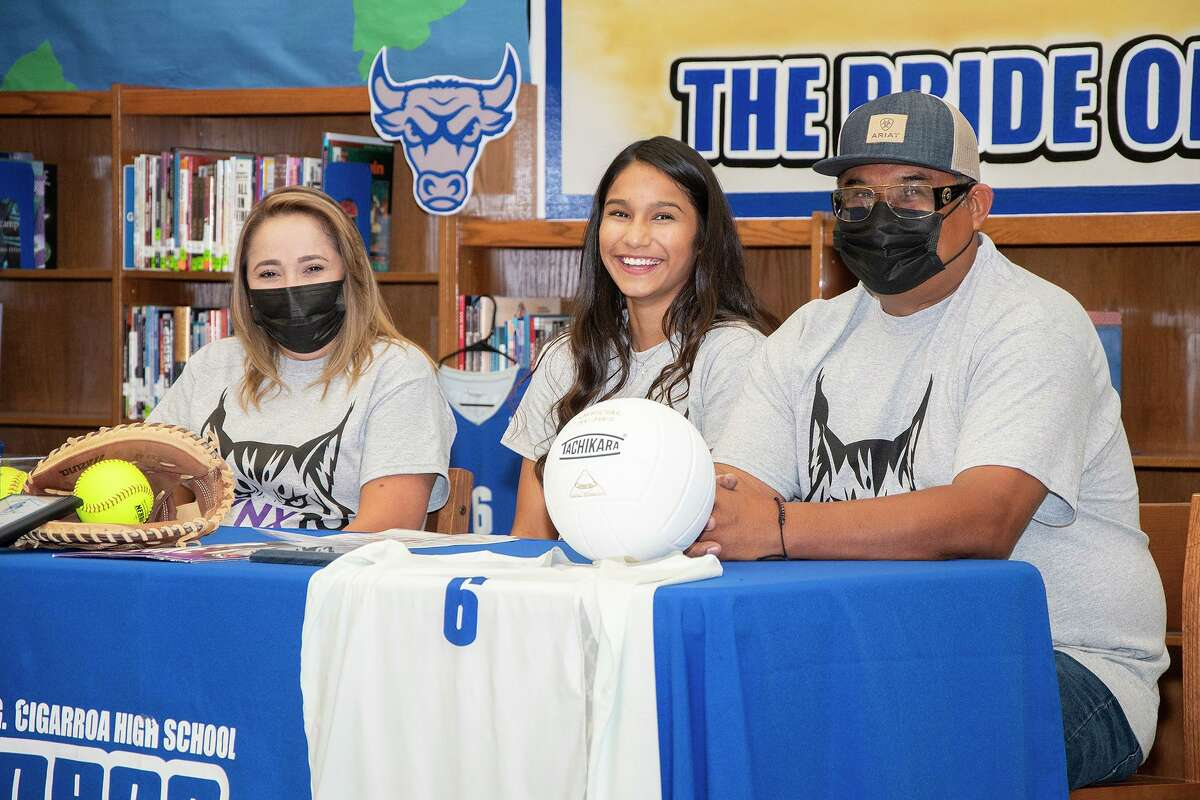 Cigarroa High School's Joselin Rodriguez was joined by her parents Janet and Juan Jose on Wednesday as she signed her National Letter of Intent to play softball and volleyball at Lincoln College.