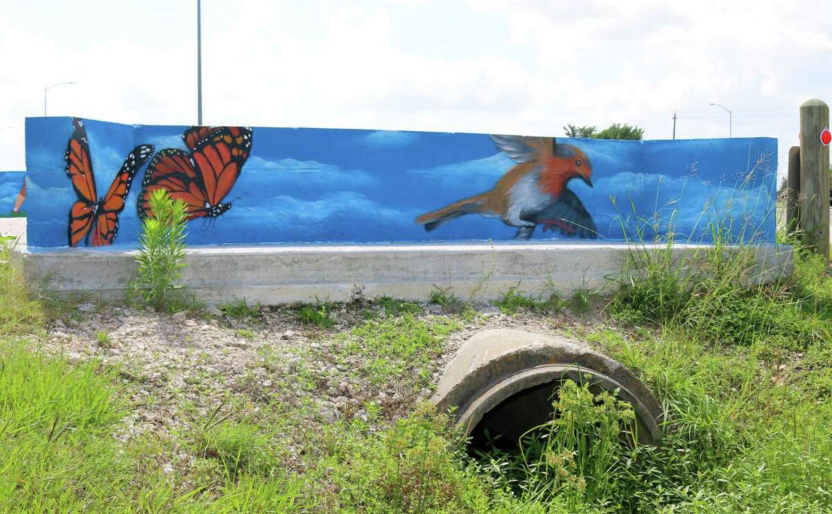 A mural at Armand Bayou Hike & Bike Trail depicts butterflies and a bird.