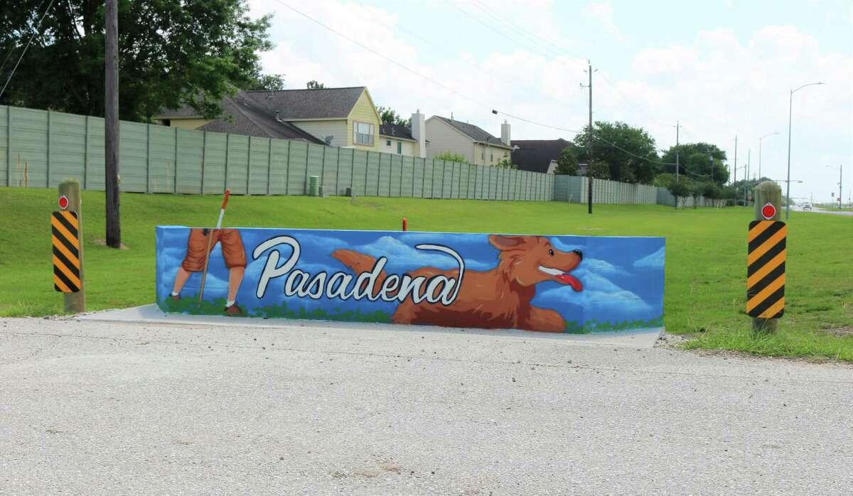 A happy dog bursts ahead of his owner on a mural at Armand bayou Hike & Bike trail.