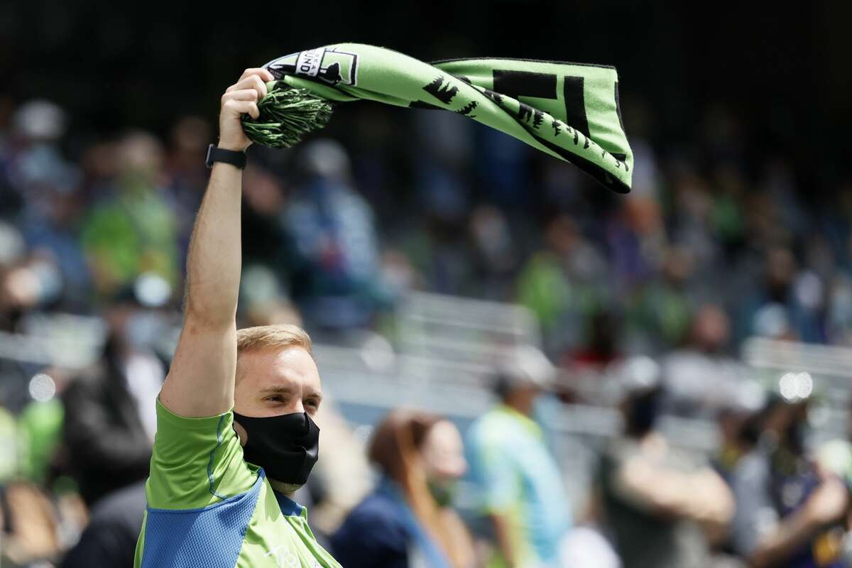 SEATTLE, WASHINGTON - MAY 23: Fans cheer before the game between the Seattle Sounders and the Atlanta United at Lumen Field on May 23, 2021 in Seattle, Washington. (Photo by Steph Chambers/Getty Images)
