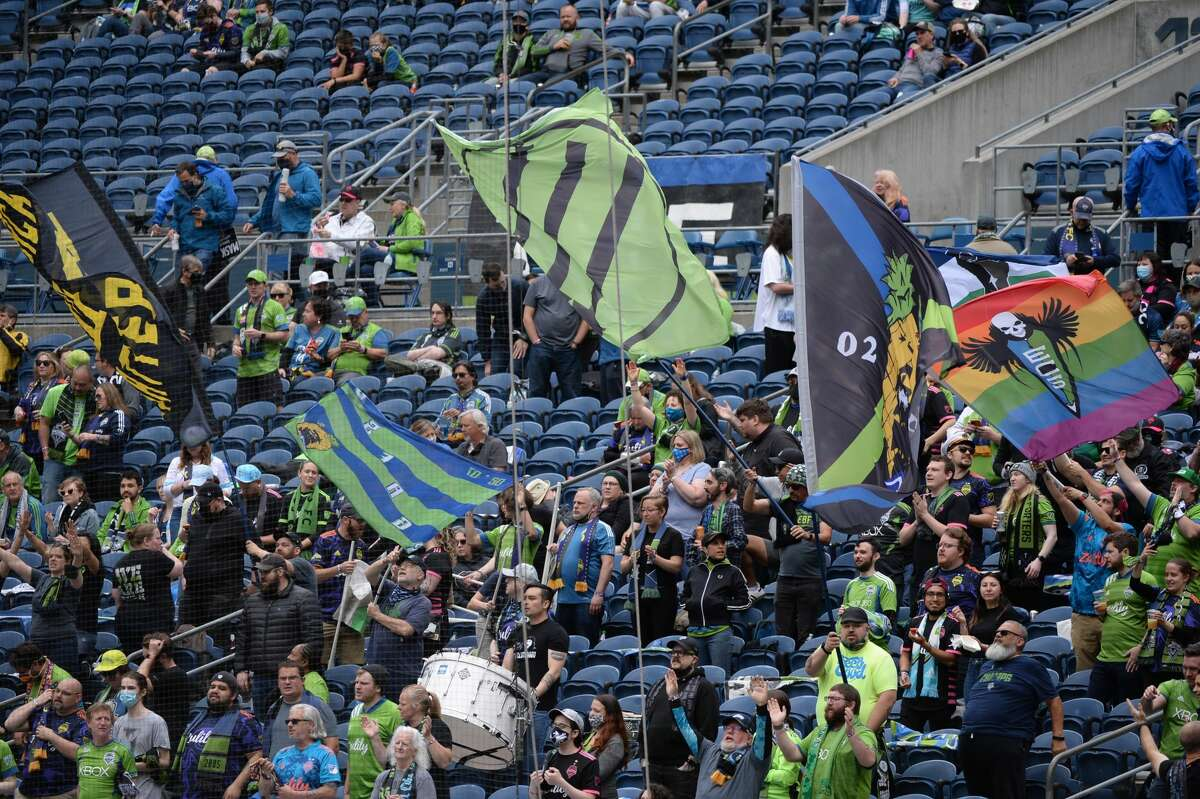 SEATTLE, WA - MAY 23: Fans seen here in the Emerald City supporters section before an MLS match between Atlanta United FC and the Seattle Sounders on May 23, 2021 at Lumen Field in Seattle, WA. (Photo by Jeff Halstead/Icon Sportswire via Getty Images)