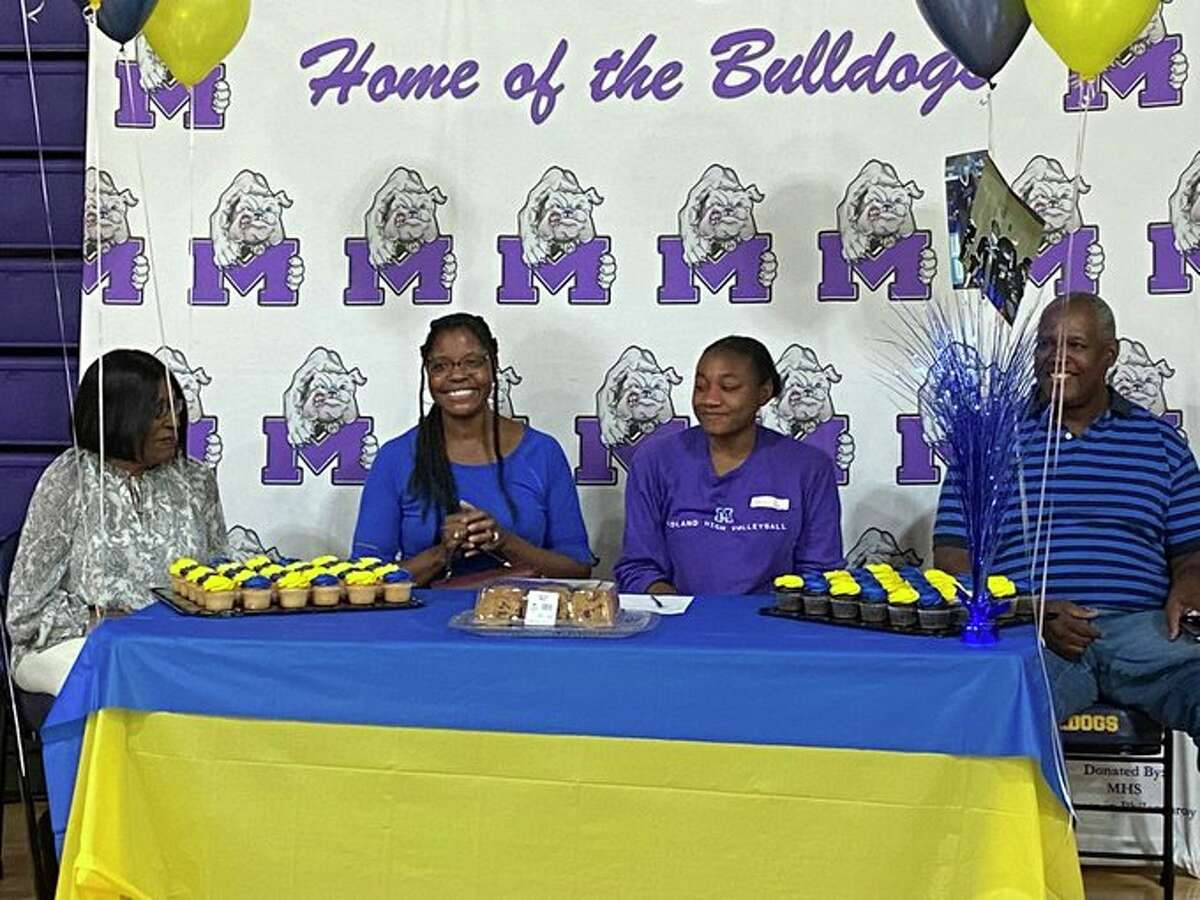 Midland High grad Joslyn Prince, surrounded by family, is celebrated during a surprise signing ceremony, June 3 at Midland High School. Prince just had her freshman season at Jarvis Christian College, but didn't have a signing ceremony in high school due to the pandemic.